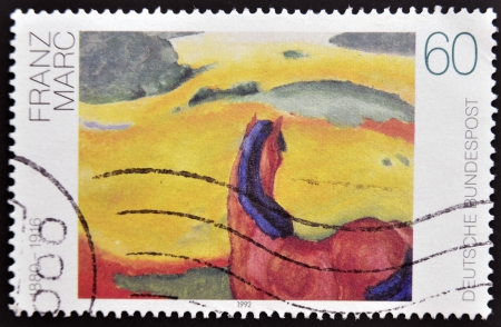 printmaker: GERMANY - CIRCA 1992: A stamp printed in Germany shows Horse in a Landscape by Franz Marc, circa 1992