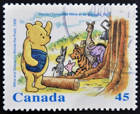 canada stamp: CANADA - CIRCA 1996: stamp printed inCanada, shows Milne and Shepard´s Winnie the Pooh, circa 1996