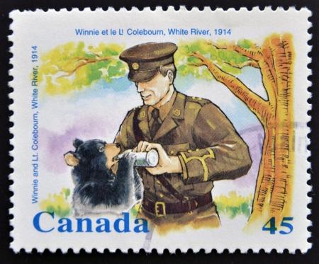 canada stamp: CANADA - CIRCA 1996: stamp printed in Canada shows Winnie and Lt. Coleboum, white river, circa 1996