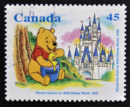 canada stamp: CANADA - CIRCA 1996: stamp printed in Canada shows Winnie the Pooh at Walt Disney World, circa 1996  Editorial