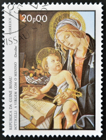 GUINEA BISSAU - CIRCA 1985: a stamp printed in Guinea-Bissau showsthe Virgin and Child by Botticelli, circa 1985