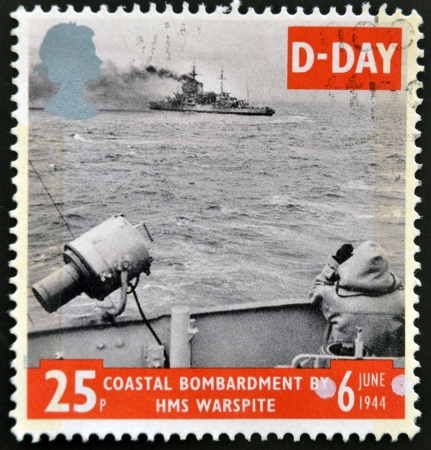 bombardment: UNITED KINGDOM - CIRCA 1994: a stamp from Great Britain shows image of a coastal bombardment, commemorating D-Day, circa 1994