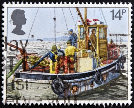 UNITED KINGDOM - CIRCA 1981: A stamp printed in Great Britain shows Cockle-dredging from Lindsey II, fishing, circa 1981 Stock Photo - 14823692