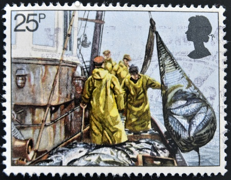 UNITED KINGDOM - CIRCA 1981: A stamp printed in Great Britain shows Hoisting Seine Net, fishing, circa 1981 Stock Photo - 14823704