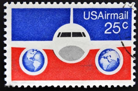 the u s  flag: UNITED STATES OF AMERICA - CIRCA 1976  A stamp printed in USA showing a Boeing 737 airliner with background of U S  flag, circa 1976