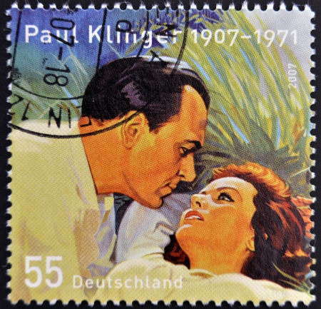 GERMANY - CIRCA 2007: A stamp printed in Germany shows Paul Klinger and Nadia Gray;  stamp based on the poster to the 1956 film Hengst Maestoso Austria, circa 2007 Stock Photo - 14938760