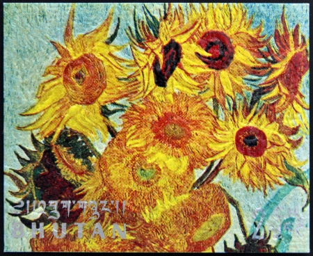 ブータン - およそ 1980年: 1980年年頃 Vincent ゴッホ ブータン ショー 12 ヒマワリ (詳細) との花瓶で印刷スタンプ 報道画像