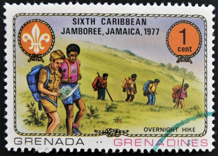 GRENADA - CIRCA 1977  A stamp printed in Grenada dedicated to the Boy Scouts shows overnight hike, circa 1977 Stock Photo - 14938763