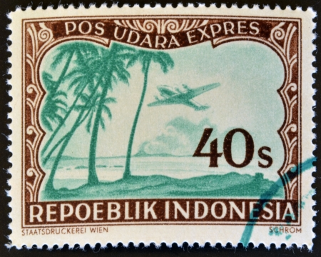 philately: INDONESIA - CIRCA 1947  A stamp printed in Indonesia shows a airplane and palm trees, circa 1947