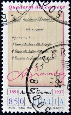 theorist: ITALY - CIRCA 1997  A stamp printed in Italy shows the prison notebooks of Antonio Gramsci, circa 1997 Editorial
