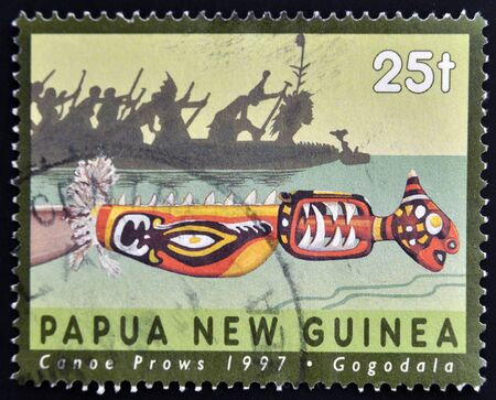 PAPUA NEW GUINEA - CIRCA 1997  A stamp printed in Papua shows canoe prows, gogodala, circa 1997 Stock Photo - 15210004