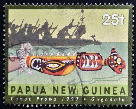 PAPUA NEW GUINEA - CIRCA 1997  A stamp printed in Papua shows canoe prows, gogodala, circa 1997 Stock Photo - 15210004