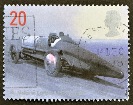 UNITED KINGDOM - CIRCA 1998: A stamp printed in Great Britain shows image of Sir Malcolm Campbell's Bluebird, 1925, circa 1998  Stock Photo - 14938750