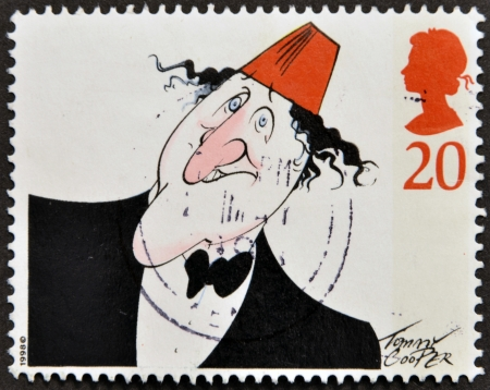 UNITED KINGDOM - CIRCA 1998  A stamp printed in Great Britain shows image of Tommy Cooper, circa 1998