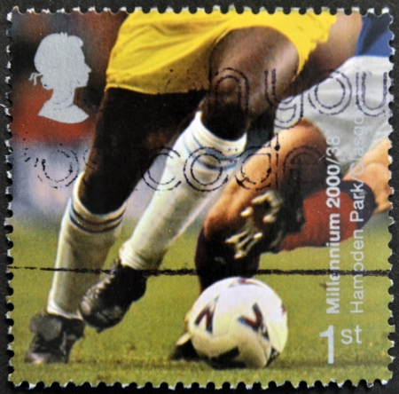 UNITED KINGDOM - CIRCA 2000  A stamp printed in Great Britain depicts a football game, Hampden Park project, Glasgow, circa 2000  Stock Photo - 14915409