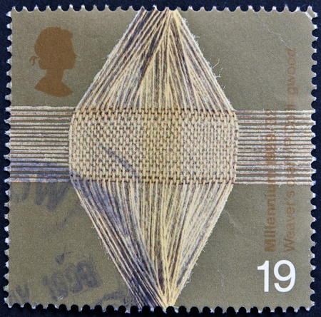 UNITED KINGDOM - CIRCA 1999: A stamp printed in Great Britain shows Woven Threads (woolen industry), circa 1999 Stock Photo - 15210012