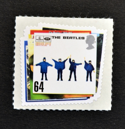 john lennon: UNITED KINGDOM - CIRCA 2007: A Stamp printed in Great Britain showing The Beatles Pop Group Album Cover, circa 2007  Editorial