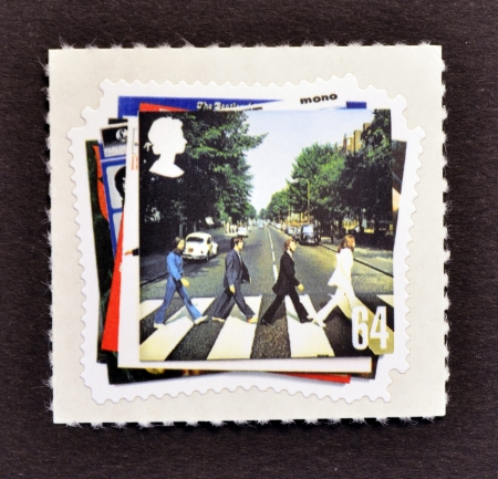 abbey: UNITED KINGDOM - CIRCA 2007: A Stamp printed in Great Britain showing The Beatles Pop Group Album Cover, circa 2007  Editorial