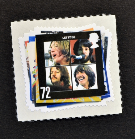 UNITED KINGDOM - CIRCA 2007: A Stamp printed in Great Britain showing The Beatles Pop Group Album Cover, circa 2007  Editöryel