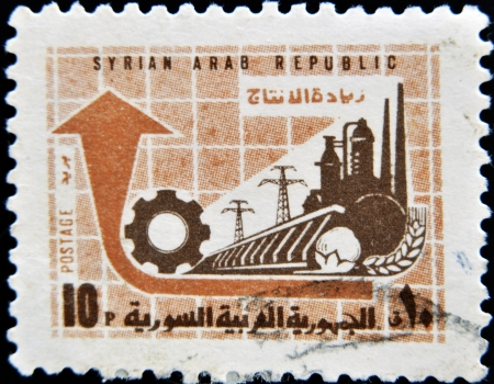 SYRIA - CIRCA 1970: stamp printed in Syria shows factory and power station, circa 1970.  photo