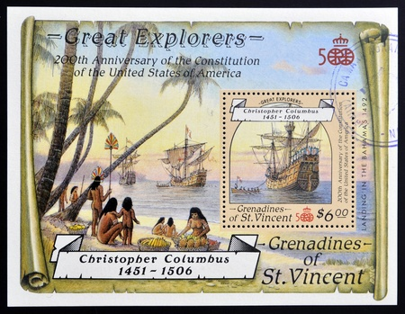 GRENADINES OF ST. VINCENT - CIRCA 1987: A stamp printed in St. Vincent shows Christopher Columbus landing in the Bahamas, circa 1987 Stock Photo - 14938766