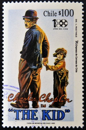 charles: CHILE - CIRCA 1995: A stamp printed in Chile shows Charles Chaplin in The Kid, circa 1995 Editorial
