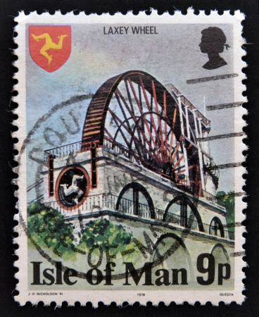 ISLE OF MAN - CIRCA 1978: A stamp printed in Isle Of Mann shows The Laxey Wheel is a large waterwheel built in the village of Laxey, circa 1978