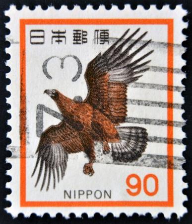 JAPAN - CIRCA 1973: A stamp printed in Japan and shows flight Golden Eagle, Aquila chrysaetos, circa 1973 Stock Photo - 15212819