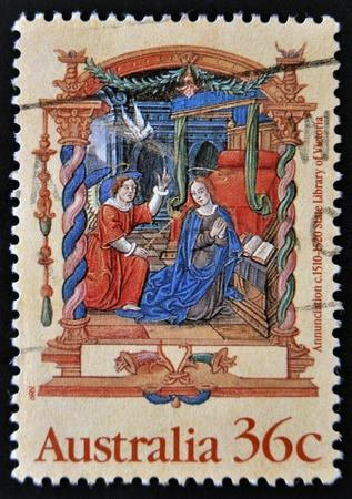annunciation: AUSTRALIA - CIRCA 1989: stamp printed in Australia shows Annunciation, from the Nicholai Joseph Foucault Book of Hours, circa 1989