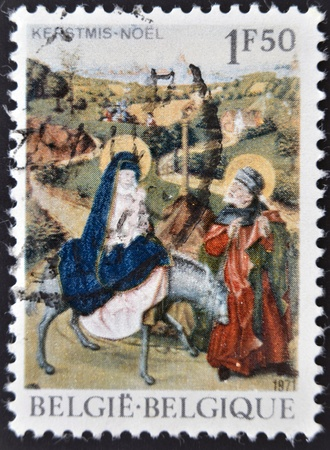 pursued: BELGIUM - CIRCA 1971: a stamp printed in tBelgium shows the biblical scene of Jesus Flight into Egypt, circa 1971  Stock Photo