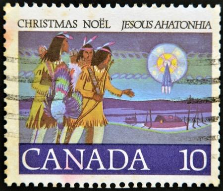 indian postal stamp: CANADA - CIRCA 1977: stamp printed in Canada, shows Hunter Following, circa 1977  Stock Photo