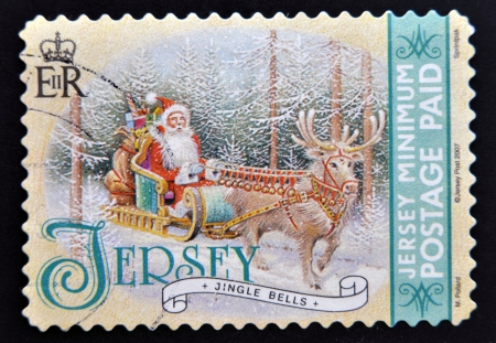 JERSEY - CIRCA 2007  A christmas stamp printed in Jersey shows jingle bells, circa 2007 photo