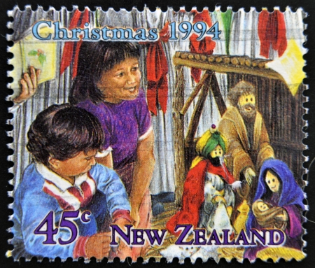 NEW ZEALAND - CIRCA 1994  A stamp printed in New Zealand shows children celebrating Christmas, circa 1994  photo