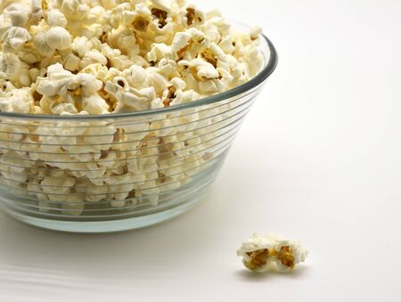 one popcorn outside the glass bowl Stock Photo - 15137726