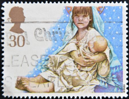 UNITED KINGDOM - CIRCA 1994: A stamp printed in Great Britain shows Children's Nativity Plays, Virgin and Child, circa 1994 Stock Photo - 15137967