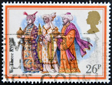 three men: UNITED KINGDOM - CIRCA 1982: A Stamp printed in Great Britain showing the Christmas Carol We Three Kings, circa 1982  Stock Photo