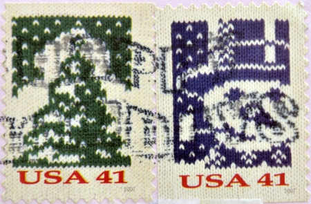 UNITED STATES OF AMERICA - CIRCA 2007: A stamp printed in USA shows Knit Christmas Tree and knit snowman, circa 2007  photo