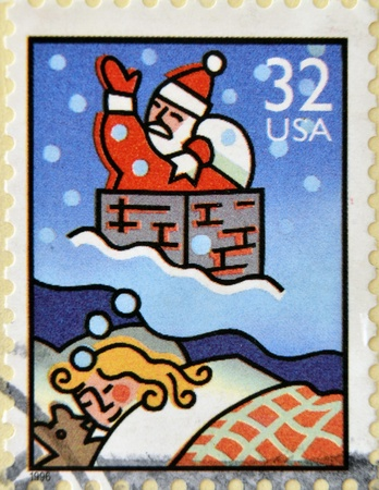 UNITED STATES OF AMERICA - CIRCA 1996: A stamp printed in USA shows Santa Claus,  circa 1996  photo