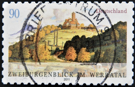 guarantor: GERMANY - CIRCA 2011: A stamp printed in Germany shows the two guarantor look in the Werratal, circa 2011  Stock Photo