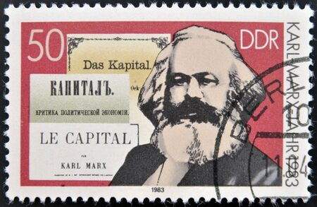 marx: GERMANY - CIRCA 1983: A stamp printed in German Democratic Republic shows Karl Marx and the book Capital , circa 1983