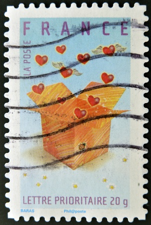 FRANCE - CIRCA 2007: A stamp printed in France shows hearts in a box, circa 2007  photo
