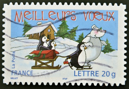 FRANCE - CIRCA 2005: A stamp printed in France shows penguins, bear and sled, circa 2005  Stock Photo - 15156201