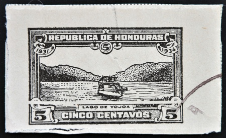 HONDURAS - CIRCA 1935: A stamp printed in Honduras shows boat on Lake Yojoa, circa 1935 photo