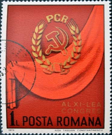 ROMANIA - CIRCA 1974: A stamp printed in Romania shows Communist party symbol on red background, circa 1974.