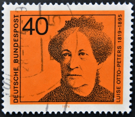 pseudonym: GERMANY - CIRCA 1974: a stamp printed in Germany shows Luise Otto-Peters, writer and journalist, circa 1974  Editorial