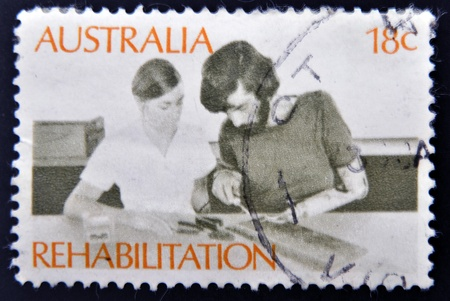 AUSTRALIA - CIRCA 1972: a stamp printed in Australia shows Amputee Assembling Electrical Circuit, Rehabilitation of the Handicapped, circa 1972