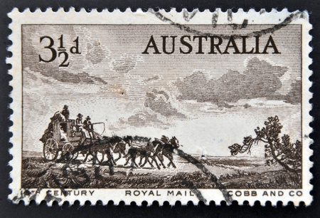 pioneers: AUSTRALIA - CIRCA 1955: A stamp printed in Australia, dedicated to Pioneers of Australias coaching era, shows Cobb and Company Mail Coach, circa 1955  Editorial