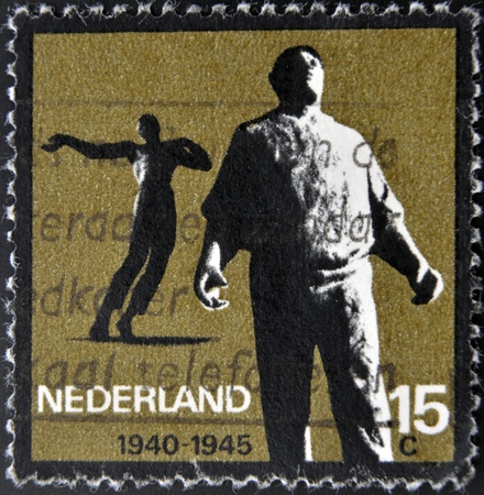 HOLLAND - CIRCA 1965  A stamp printed in Holland from the  Resistance Commemoration  issue shows Docker  Amsterdam  and Killed in Action  Waalwijk , circa 1965  Stock Photo - 15294065