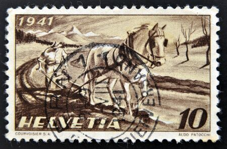 SWITZERLAND - CIRCA 1941: a stamp printed in Switzerland shows Farmer Plowing, circa 1941