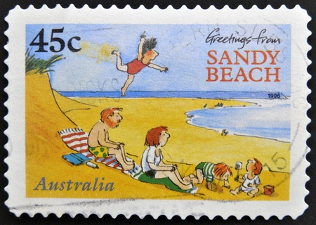 AUSTRALIA - CIRCA 1996: A stamp printed in australia shows greetings from sandy beach, circa 1996 Stock Photo - 15370501